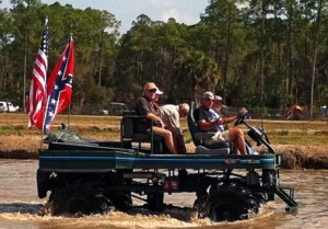 A swamp buggy sporting the US & Confederate flags