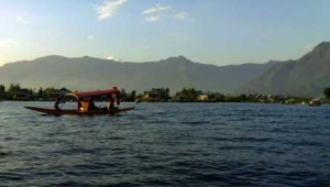 A view of the Dal Lake with a shikara boat