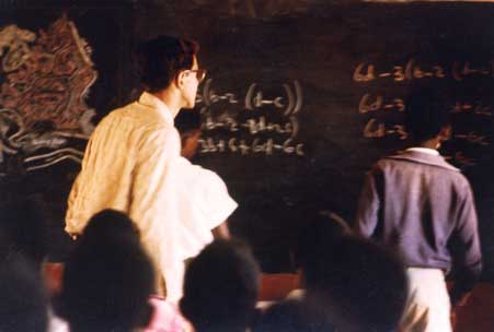 Alan at the chalkboard with students Teaching in the Ivory Coast