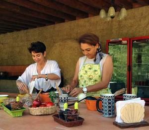 Olivia &  Eréndira doing a food demonstration of their Secret Sauce
